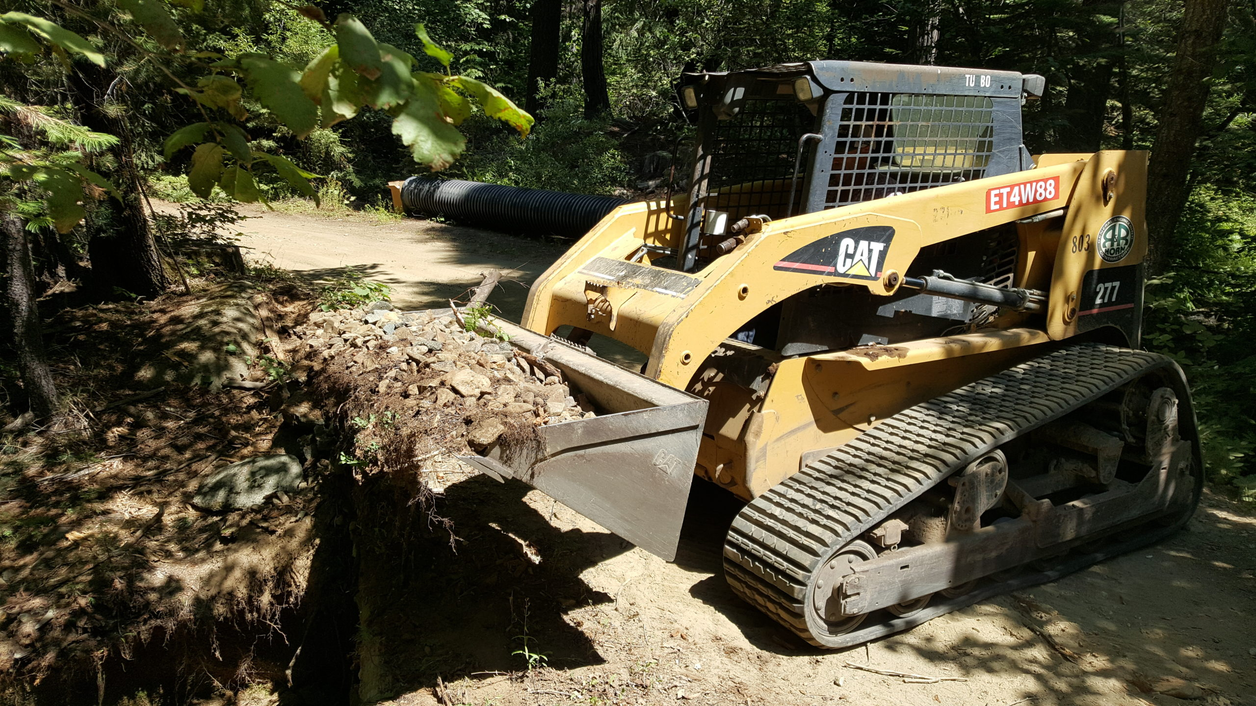 Bobcat services in Chico digging a trench